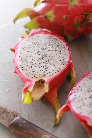dragonfruit: fresh sliced dragonfruit on chopping board Stock Photo