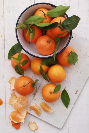 clementines: fresh orange clementines on wooden background
