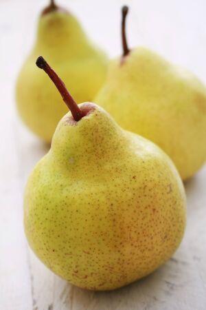 scurvy: fresh pear fruit on wood background