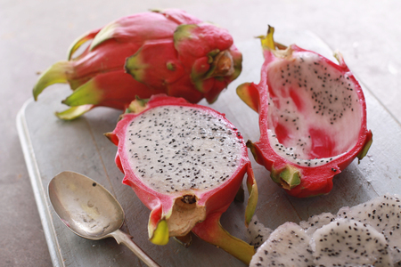 dragonfruit: fresh sliced dragonfruit on chopping board Stock Photo