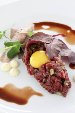 steak tartare: plated traditional beef steak tartare appetizer meal