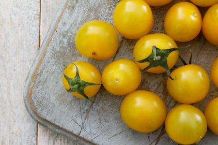 preparing small yellow tomatoes Stock Photo