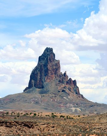 dikes: El Capitan, also called Agathla by the Navajo people, rises dramatically from the desert in Monument Valley, Arizona.