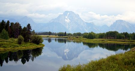 Mount Moran and Skillet Glacier are reflected in a pond on a rainy afternoon in Grand Teton National Park, Wyoming. Stock Photo - 1357740
