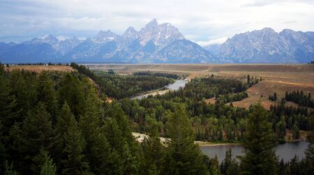 The Grand Teton and Snake River, Wyoming, on a rainy summer evening. Stock Photo - 1396834