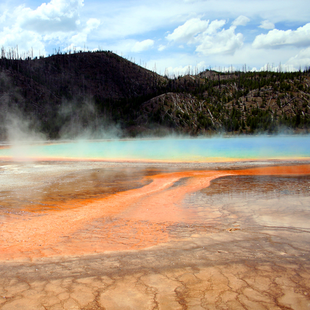This grand prismatic spring is but one of the amazing geothermal wonders seen in Yellowstone National Park, Wyoming. Stock Photo