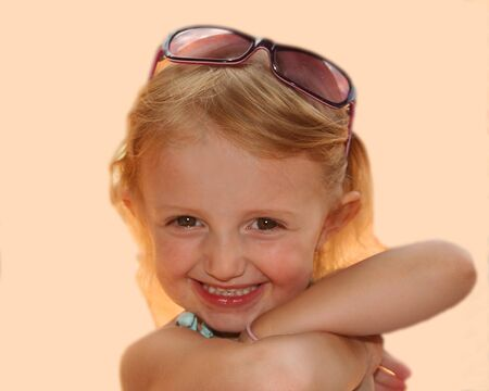 This three-year-old pixie just loves showing off her new sunglasses. Stock Photo - 1606708