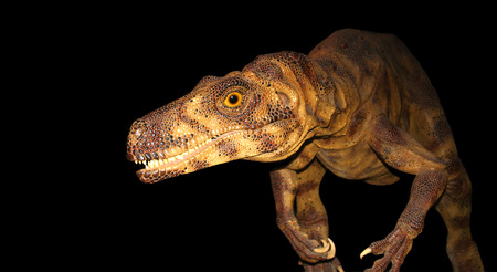 alarming: A hungry Herrerasaurus is on the prowl on a pitch black Late Triassic night. Stock Photo