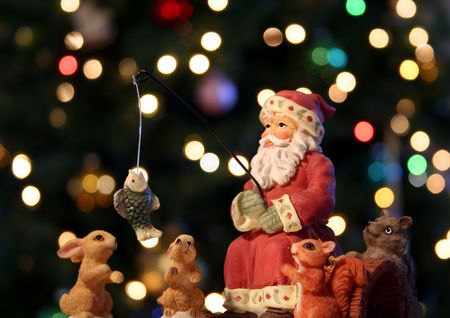 kris kringle: Santa Claus and his woodland friends go fishing on Christmas Eve with multicolored lights dancing off the forest trees
