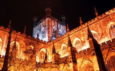 A magnificent church, the Chester Cathedral in England is a glowing medieval shrine against the darkness of night.