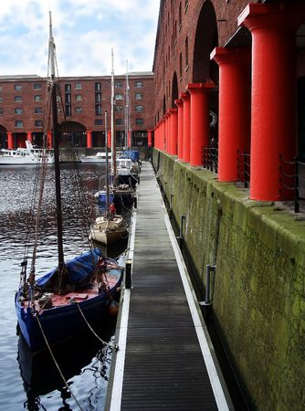A line of boats await their masters at the Albert Dock, Liverpool, in England. photo