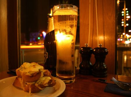 christmastide: A Beer and Garlic Cheese Toast at Christmastide Stock Photo