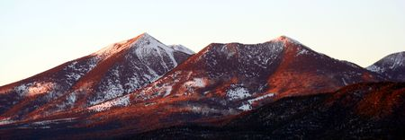 mount humphreys: A winter view of the southern slopes of the San Francisco Peaks, Arizona, at sunset Stock Photo