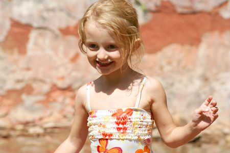 four year old: This four-year-old pixie just loves showing off her new swimsuit down at the creek.