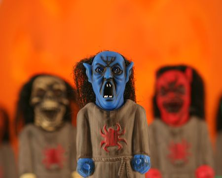 A Trio of Monstrous Ghouls: Blue Vampire, Red Demon and Skeleton