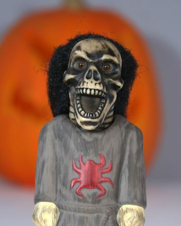 ghoulish: An Angry Skull Creature Stands Screaming Before A Giant Jack-o-lantern Stock Photo