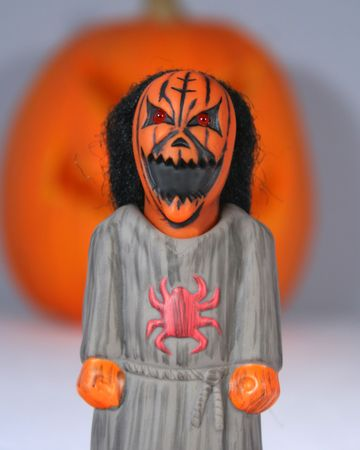 An Angry Pumpkin Head Stands Screaming Before A Giant Jack-o-lantern Stock Photo