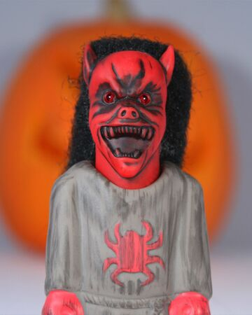 ghoulish: An Angry Demon Stands Screaming Before A Giant Jack-o-lantern