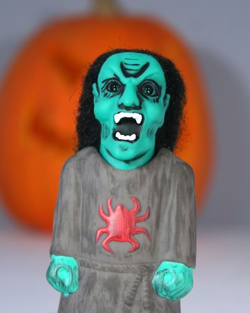 An Angry Ghoul Stands Screaming Before A Giant Jack-o-lantern