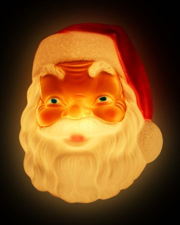 wrinkled brow: A Smiling Santa Claus Face Glows in the Dark at Christmas