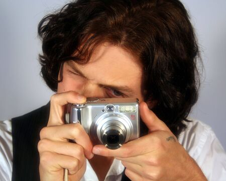 long nose: A Handsome Young Man Takes a Picture with a Digital Camera