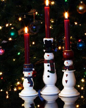 A Trio of Snowman Candles in Front of a Christmas Tree Stock Photo - 4053217