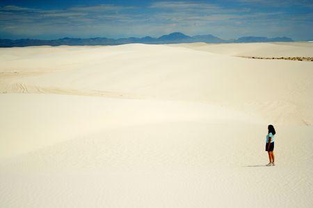 contemplates: A Woman Contemplates White Sands National Monument Stock Photo