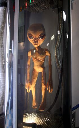 extra terrestrial: A Space Alien in a Stasis Chamber Stock Photo