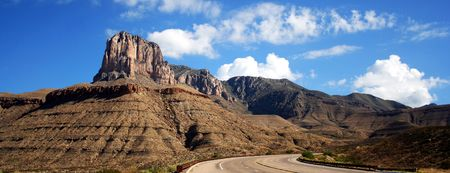 guardrails: A Highway to Guadalupe Mountains National Park, Texas, with El Capitan Looming Ahead Stock Photo