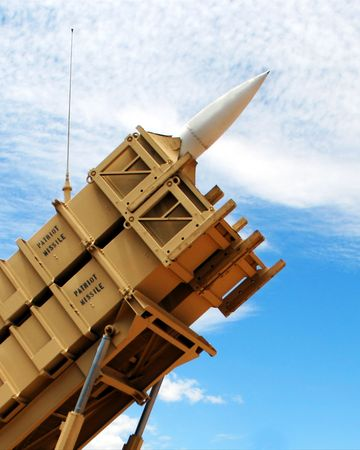 A Patriot Missile Poised in its Launcher Against a Cloudy Sky Imagens