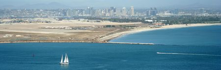 speedboats: A View of a Sailboat and Downtown San Diego from Point Loma Stock Photo