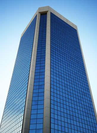 A Tall Glass Tower Reflects the Blue of the Sky