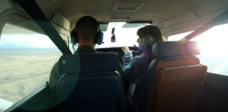 A Couple in a Small Plane Fly in the Sun photo