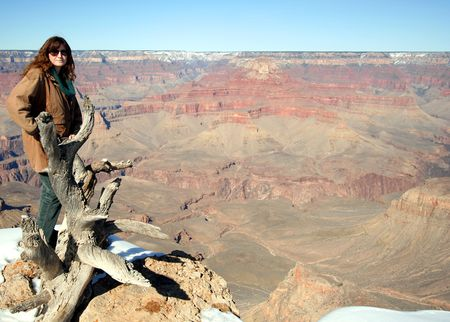 A Woman on the South Rim of the Grand Canyon in Arizona  photo