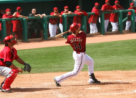 Conor Jackson gets a hit in an Arizona Diamondbacks game against the Cincinnati Reds on March 16, 2010, at Tucson Electric Park in Tucson, Arizona, during spring training.