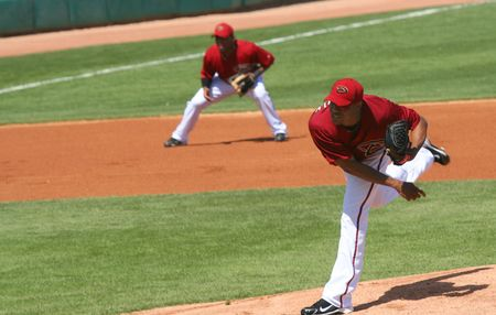 Edwin Jackson pitches in an Arizona Diamondbacks game against the Los Angeles Angels on March 11, 2010, at Tucson Electric Park in Tucson, Arizona, during spring training. Tony Abreu is playing third base.
