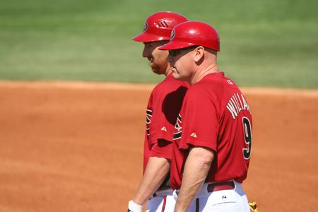 First base coach Matt Williams and base runner Adam LaRoche in an Arizona Diamondbacks game against the Los Angeles Angels on March 11, 2010, at Tucson Electric Park in Tucson, Arizona, during spring training.