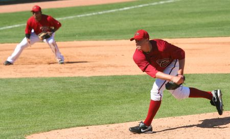 Bryan Augenstein pitches in an Arizona Diamondbacks game against the Los Angeles Angels on March 11, 2010, at Tucson Electric Park in Tucson, Arizona, during spring training. Tony Abreu is playing third base.
