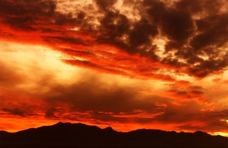 arizona sunset: A Blazing Arizona Sunset Over the Huachuca Mountains