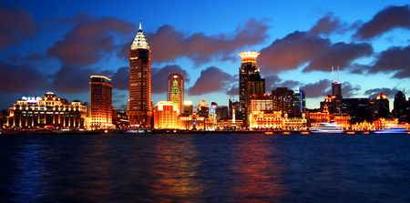 A View of the Bund, Shanghai, China, at Twilight. The Huangpu River is in the Foreground taken July 19, 2010 Editorial