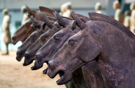 A Line of Terracotta Horses, Xi'an, China, Soldiers in the Background Editorial