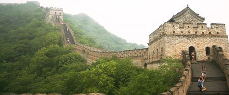 A Man on One Knee Photographs a Woman on the Great Wall of China on July 15, 2010 Éditoriale