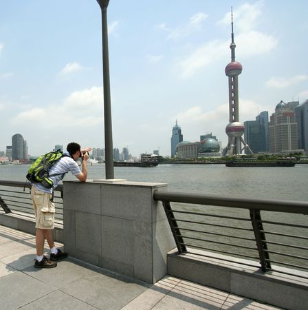 huangpu: A Man Photographs the Oriental Pearl TV Tower from Across the Huangpu River