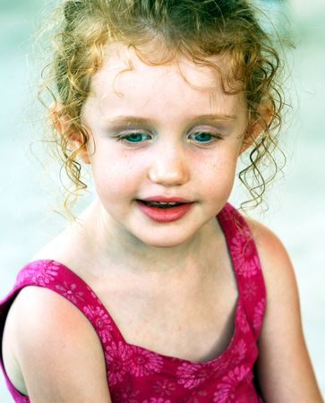 ringlets: A Little Girl with Blue Eyes and Ringlets in Her Hair