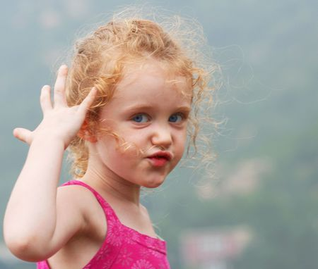 A Little Girl with Big Blue Eyes Making a Face  Stock Photo - 7700558