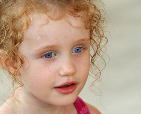 ringlets: A Little Girl with Big Blue Eyes and Ringlets in Her Hair  Stock Photo