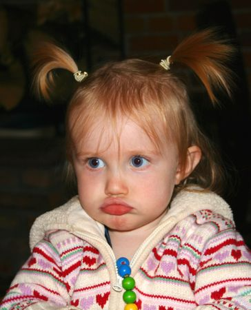 pouty: A Little Girl with a Pouty Look on Her Face Stock Photo