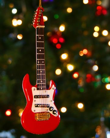 A Red Electric Guitar Ornament and Lights on a Christmas Tree