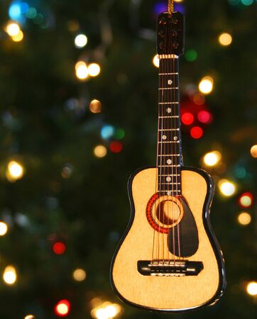 A Folk Guitar Ornament and Lights on a Christmas Tree