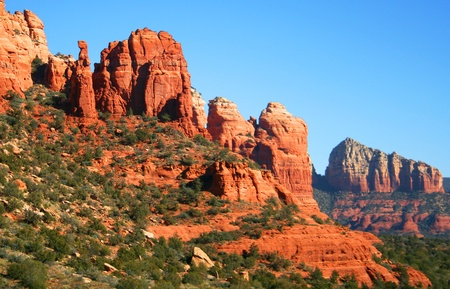 A View of Red Rocks, Blue Sky, and Green Trees Near Sedona, Arizona photo